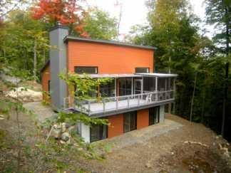 Une habitation leed platine en r action aux manoirs et for Construire maison minimaliste